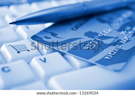 Credit card over a keyboard with a SHOPPING CART conceptual key