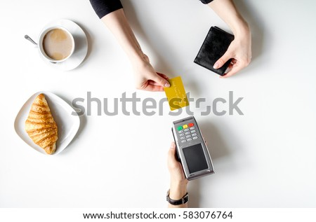 Credit card payment for business lunch on white table top view