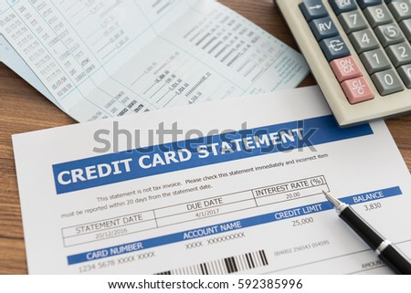 credit card statement with bank account, calculator on desk. Stock photo ©