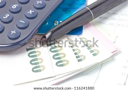 Credit card, Thai bank notes and calculator with bankbook.
