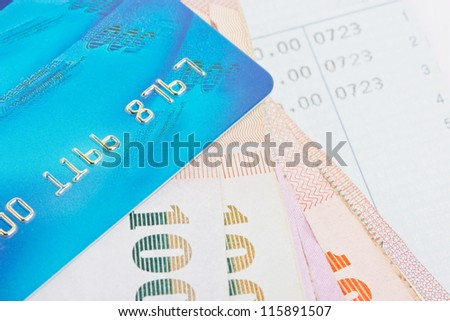Credit card, Thai bank notes with bankbook. - stock photo