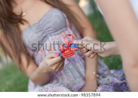 Credit card with a bow in a gift to the young woman. Small depth of sharpness. Business style