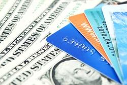 Credit cards and dollar bills