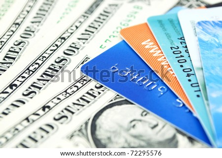 Credit cards and dollar bills