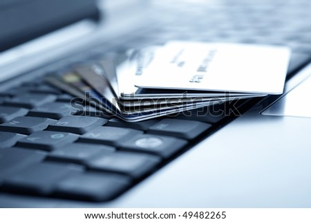 Credit cards and laptop. Shallow DOF