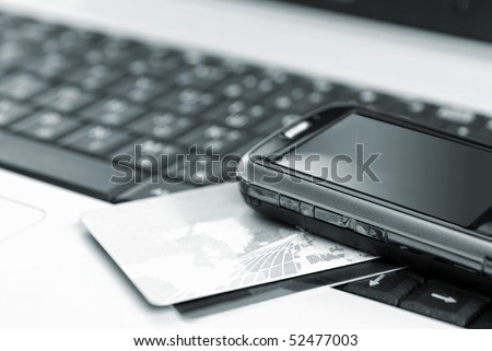 Credit cards and mobile phone on the notebook