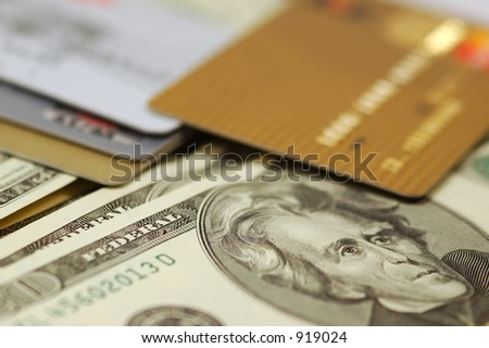 Credit Cards atop Paper Money