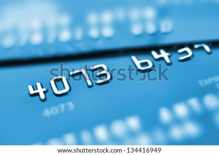 Credit cards in blue tone with shallow depth of field.