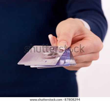 credit cards in woman's hand