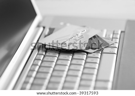 Credit cards on a laptop keyboard