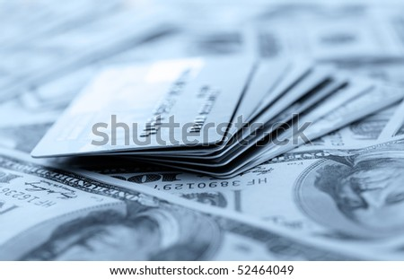 Credit cards on dollars background. Shallow DOF