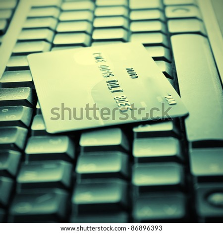 Credit cards on the keyboard,close up photo - stock photo