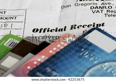 Credit cards soft image with Official receipt in focus.