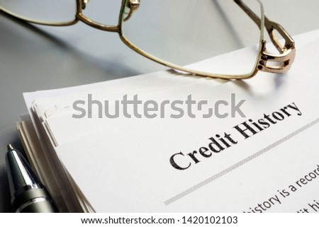 Credit history report papers and pen. Stock photo ©