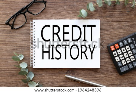 Credit History. text on white paper on wood table background Stock photo ©
