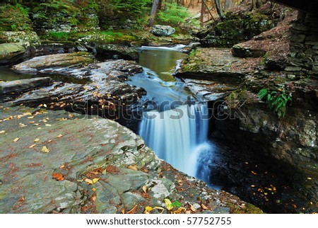 Creek in woods with rocks and foliage