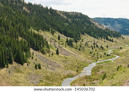 Creek winding through an alpine valley in southern Colorado