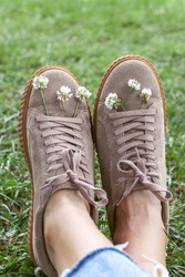 Creeper shoes with flowers in a beautiful nature background. Concept of resting, relaxing and lifestyle.
