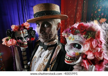 Creepy character in hay hat with a couple of hot skulls decorated with flowers.