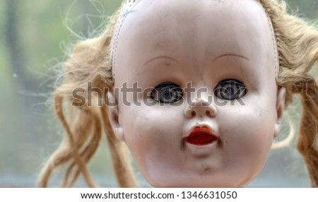 Creepy doll. Strange Look Of Creepy Doll. Scary face of weird vintage doll. The photo of doll's head. Creepy Deamonic horror Doll.
