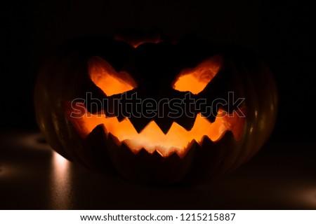Creepy Glowing Halloween pumpkin #1215215887