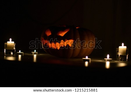 Creepy glowing pumpkin for Halloween with candles #1215215881