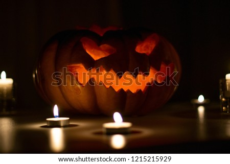 Creepy glowing pumpkin for Halloween with candles #1215215929