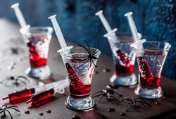 Creepy Halloween Party Cocktails with Syringes of Grenadine Syrup as Blood
