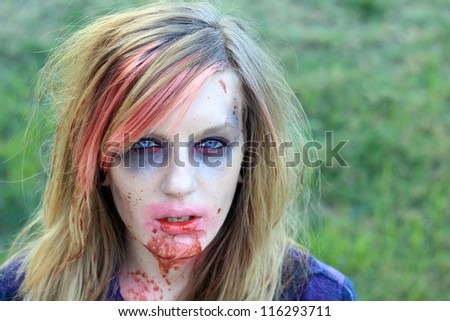 Creepy Halloween Woman Zombie With Blood Dripping on Face