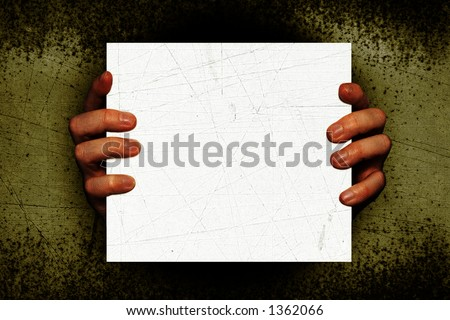 Creepy Hands holding a white blank sign on a grunge textured background. Add your own text or Image. This could make a nice halloween invitation
