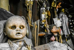 Creepy old dolls in the abandoned Island of the Dolls, Xochimilco, southern Mexico City