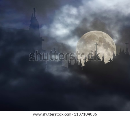 Creepy old graveyard in a foggy and overcast rising full moon night