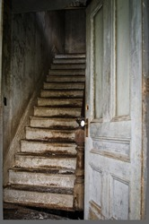 Creepy scary stairway from an old dilapidated haunted house.