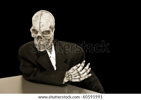 creepy skeleton in a dusty suit on a black background