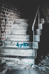 Creepy staircase in abandoned warehouse