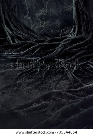 Stock Photo creepy trees with twisted roots and two lizard on misty night forest. Scary concept.