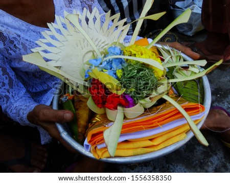 Cremation ceremony for Balinese Hindu, Indonesia, is very complex and detailed in terms of offering preparation. Most of all, white and yellow color always dominate the atmosphere, like this offerings
