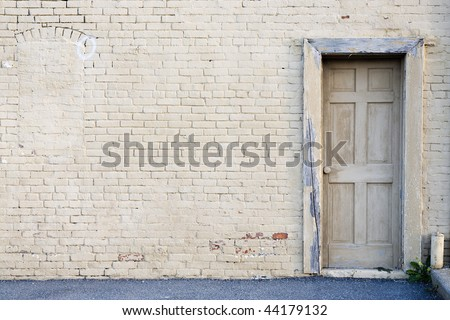 creme brick wall with door background