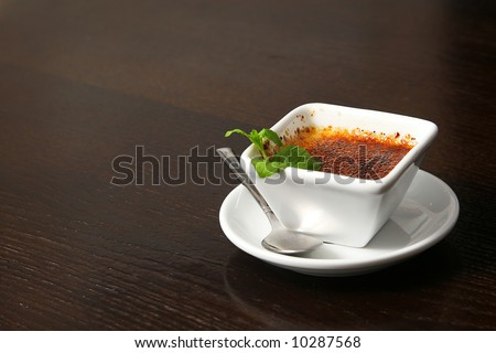 creme brulee on the table in smal white cup - stock photo