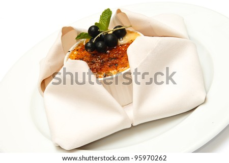 Creme brulee. Traditional French vanilla cream dessert with blackberries on top