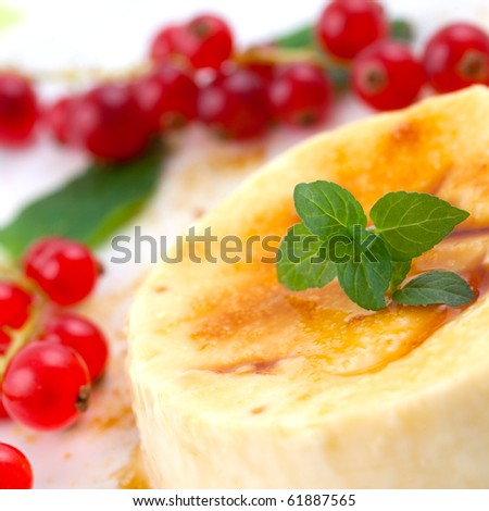 creme brulee with fruit and mint