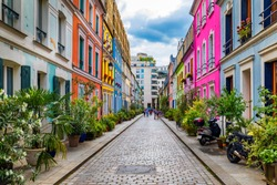 Cremieux Street (Rue Cremieux), Paris, France. Rue Cremieux in the 12th Arrondissement is one of the prettiest residential streets in Paris. Colored houses in Rue Cremieux street in Paris. France.