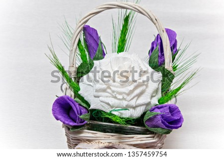 Crepe paper floral arrangement with white rose and purple rosebud, isolated on background. #1357459754