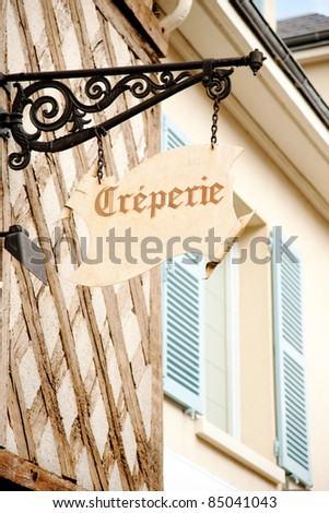 Creperie sign on historic house in Chartres, France