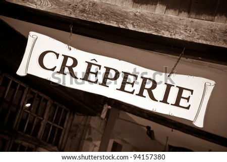 Creperie sign on historic house in Dinan, Brittany