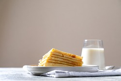 Crepes, thin pancakes on a plate. comfor food, delicious homemade breakfast with thin pancakes and milk.