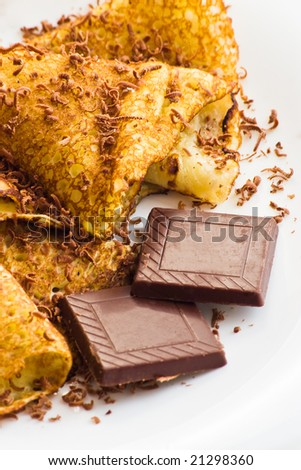 crepes with chocolate on white plate