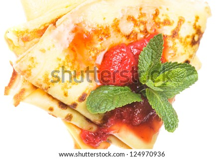 Crepes with strawberry jam and mint isolated on white background
