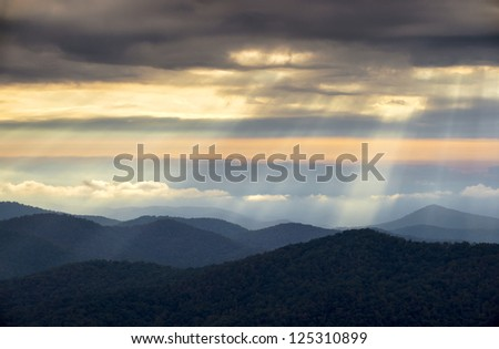 Crepuscular Light Rays and Sunbeams from Blue Ridge Parkway NC on a spring morning in the Appalachian Mountains near Asheville North Carolina
