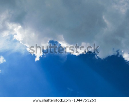 Shutterstock crepuscular rays at the ends of a cumulus clouds occupying the upper part of the image and in the background a deep blue sky, Sao Paulo, Brazil